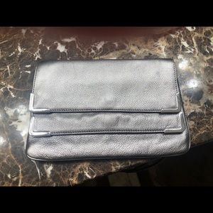 Michael Kors Silver 2 pocket envelope clutch.